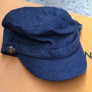 02c7285fab491 NWT ALDO DENIM BLUE WITH BUTTONS CAP SIZE SMALL